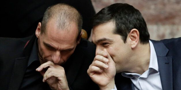 Greece's Prime Minister Alexis Tsipras chats with Greece's Finance Minister Yanis Varoufakis during a...
