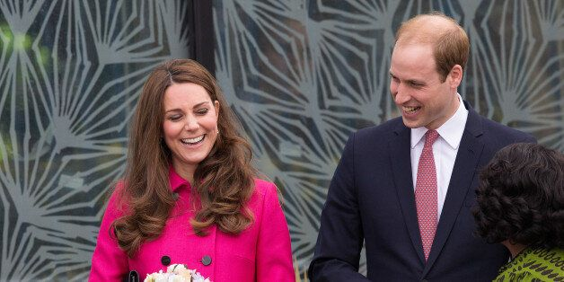 Britain's Prince William and Britain's Kate, Duchess of Cambridge smile as they as they leave the Stephen...