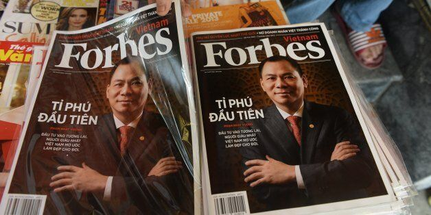 A copy of the newly launched Vietnamese version of Forbes Magazine is seen on sale at a roadside newsstand...