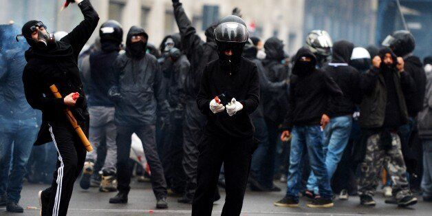 Demonstrators face off against police during a demonstration against Milan's Universal Exposition, EXPO2015,...