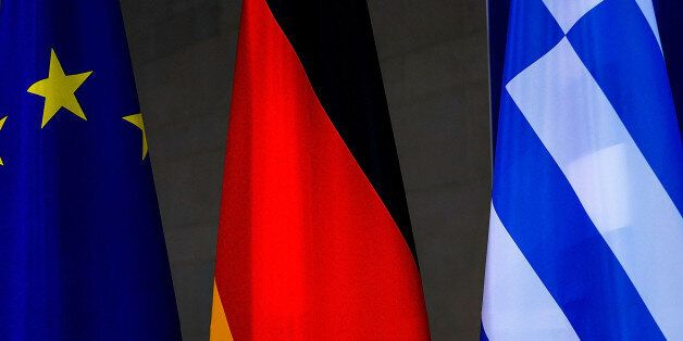 BERLIN, GERMANY - MARCH 23: The flags of the European Union, Greece and Germany stays beside as German...
