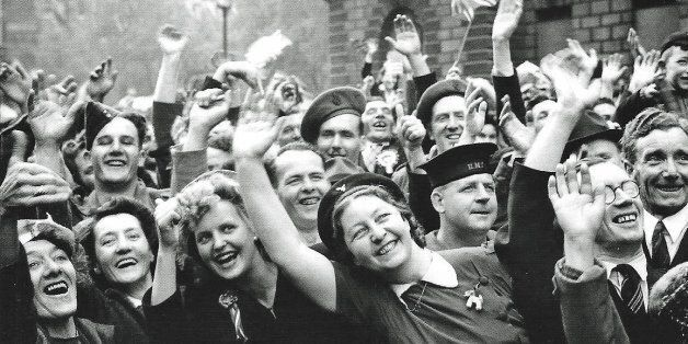 Jubilant crowds in Parliament Street celebrate the end of the war in Europe on the 8th May