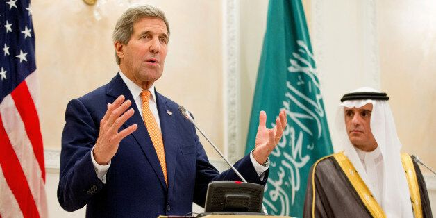 U.S. Secretary of State John Kerry, left, and Saudi Foreign Minister Adel al-Jubeir, right, hold a joint...