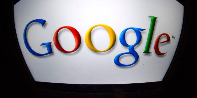 The 'Google' logo is seen on a tablet screen on December 4, 2012 in Paris. AFP PHOTO / LIONEL BONAVENTURE...