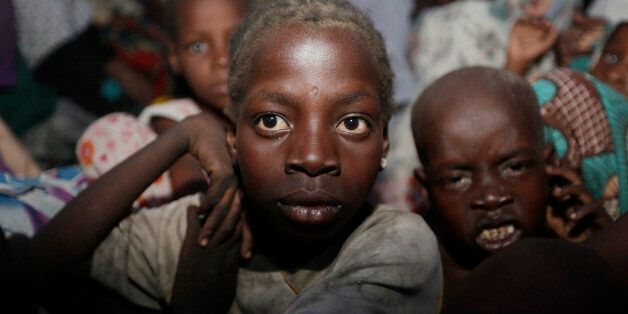 Women and children rescued by Nigeria soldiers from Islamist extremists at Sambisa forest arrive at a...