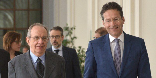 Italian Economy Minister Pier Carlo Padoan (L) welcomes Dutch Finance Minister and president of the Eurogroup,...