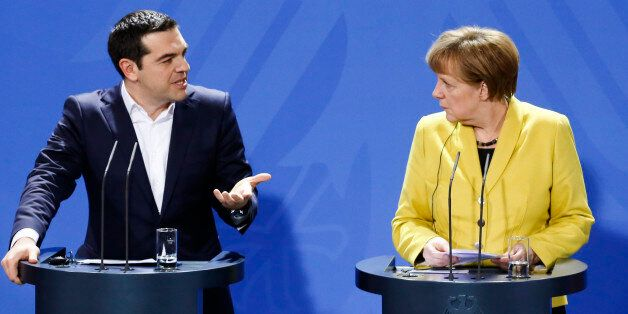 German Chancellor Angela Merkel, right, and the Prime Minister of Greece Alexis Tsipras brief the media...
