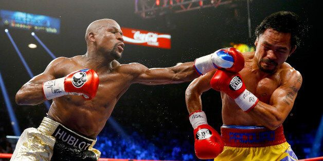 LAS VEGAS, NV - MAY 02: Floyd Mayweather Jr. throws a left at Manny Pacquiao during their welterweight...