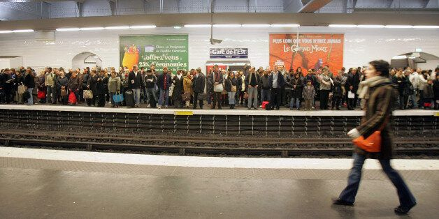 Commuters wait for a metro, at Gare de l'Est station in Paris, Monday Nov. 19, 2007, on the sixth day...