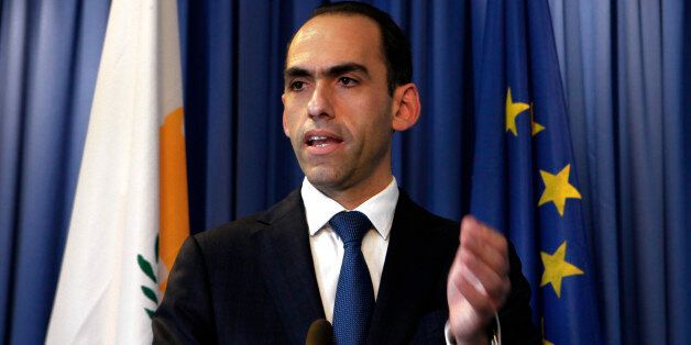 Cyprus' finance minister Harris Georgiades speaks to the media during a press conference at the Ministry...