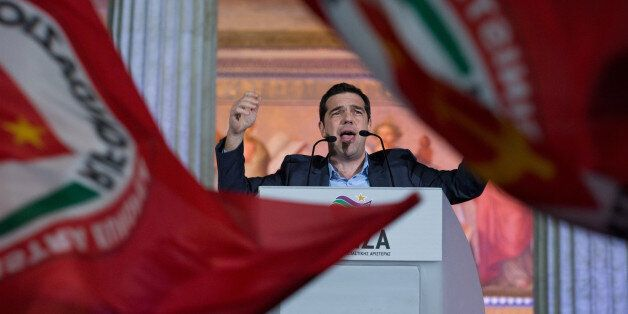 ATHENS, GREECE - JANUARY 25: Head of radical leftist party Alexis Tsipras speaks to supporters after...