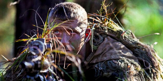 Army Staff Sgt. Mathew Fox waits to engage a target in the live-fire stalk event during the 2012 International...