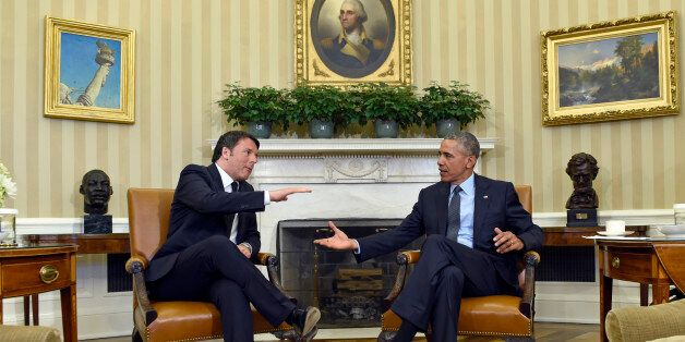President Barack Obama reaches to shake hands with Italian Prime Minister Matteo Renzi in the Oval Office...