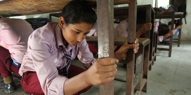 Students practice earthquake drill. Jana Bikash Secondary School, Matatirtha, is in the process of being...