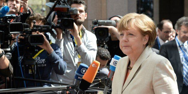 Germany's Chancellor Angela Merkel arrives at the European Council headquarters for an extraordinary...