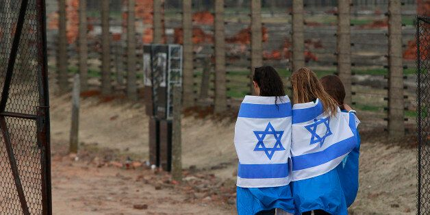 Participants with Israeli flags arrive for the annual silent March of the Living at the Auschwitz-Birkenau...