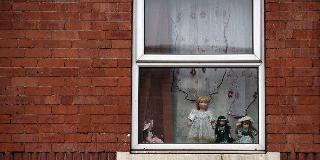 Dolls are displayed in an upper floor window of a house in the Eastwood area of Rotherham, South Yorkshire,...