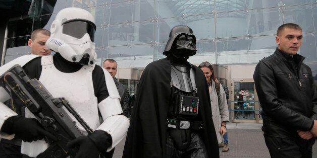 Darth Vader, leader of Ukraine's Internet Party, surrounded by guards passes by a shop in Kiev, Ukraine,...