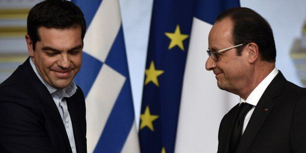 French president Francois Hollande (R) and Greece's Prime Minister Alexis Tsipras are seen during a press...