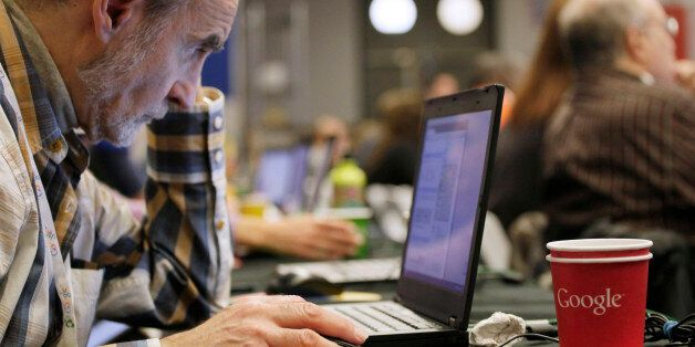 A man works on a laptop Google at Google offices, Oct. 17, 2012 in New York. (AP Photo/Mark