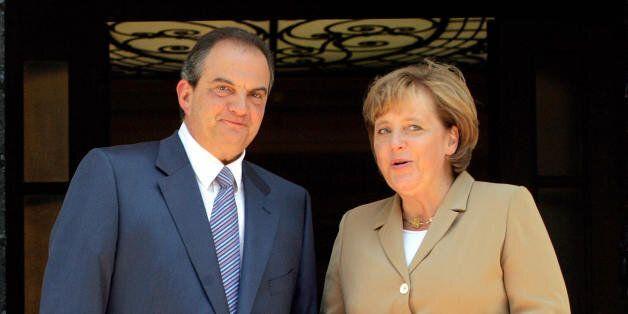 Athens, GREECE: Greek Prime Minister Kostas Karamanlis (R) greets German Chancellor Angela Merkel upon...