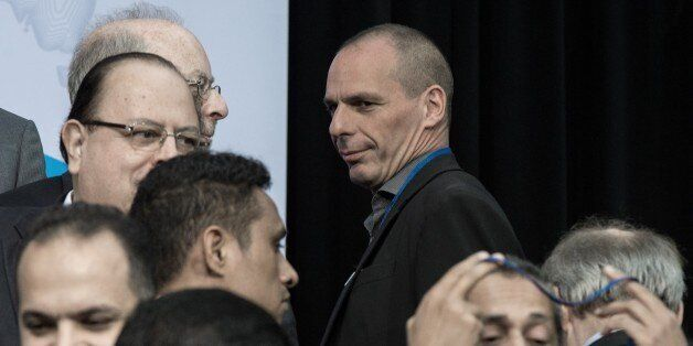 Greek Finance Minister Yanis Varoufakis arrives to pose for the International Monetary and Financial...