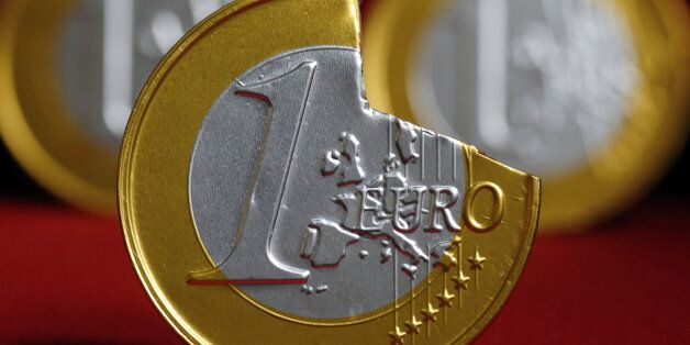 A picture taken on June 16, 2012 in Paris, shows a one-euro coin with a piece broken off. AFP PHOTO THOMAS...