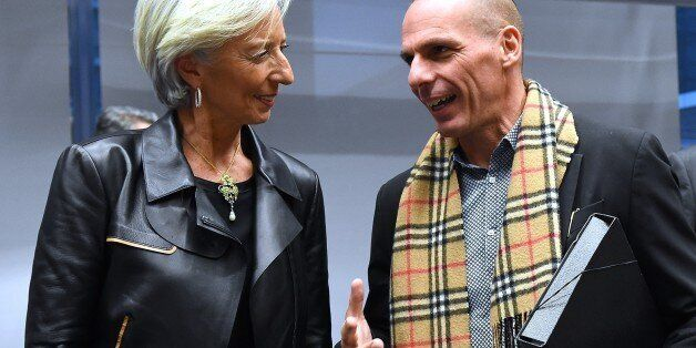 Greek Finance Minister Yanis Varoufakis (R) speaks with International Monetary Fund (IMF) Director Christine...