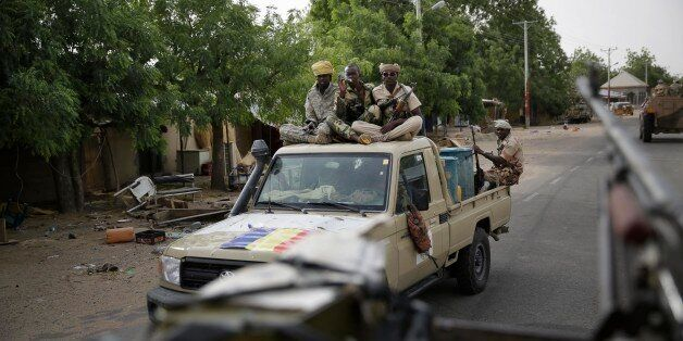 Chadian soldiers ride on trucks and pickups in the city of Damasak, Nigeria, Wednesday, March 18, 2015....