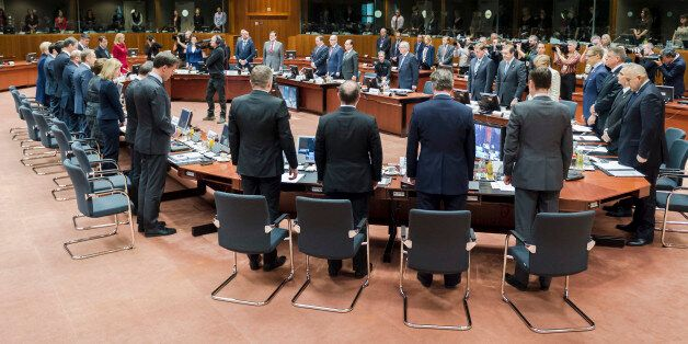 European Union heads of state observe a moment of silence during a round table at an emergency EU summit...