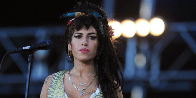 British singer Amy Winehouse performs during the 'Rock in Rio' music festival in Arganda del Rey near...
