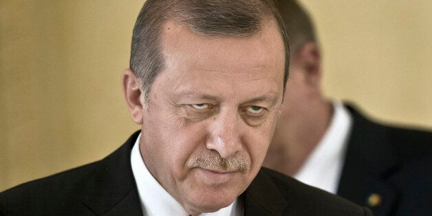 Turkish President Recep Tayyip Erdogan and Romanian President Klaus Iohannis, background, leave after...