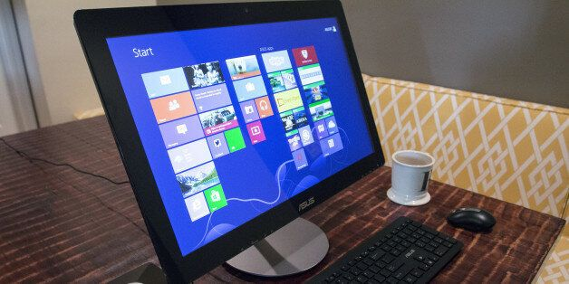 This April 24, 2014 photo shows the ASUS All-in-One PC ET2322 desktop computer, in Decatur, Ga. The computer...