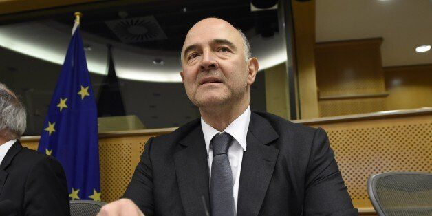 EU Commissioner of Economic and Financial Affairs, Taxation and Customs Pierre Moscovici talks during...