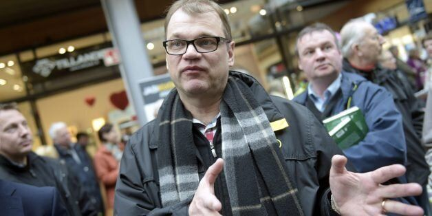 Chairman Juha Sipila of the Centre Party campaigns in Espoo, Finland, Saturday, April 18, 2015, ahead...