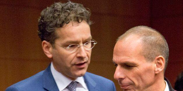 Greek Finance Minister Yanis Varoufakis, right, speaks with Dutch Finance Minister Jeroen Dijsselbloem,...