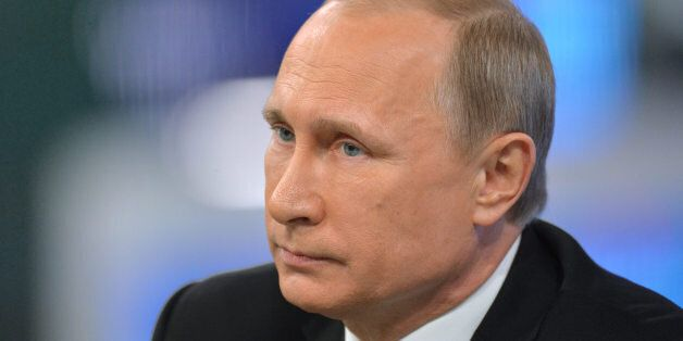 Russian President Vladimir Putin listens during an annual call-in show on Russian
