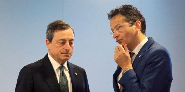 Eurogroup president Jeroen Dijsselbloem, right, and President of the ECB, Mario Draghi talk during the...