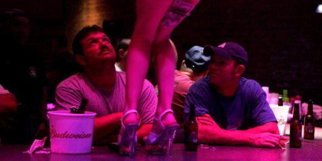 NEW ORLEANS - SEPTEMBER 20: A stripper dances at the Deja Vu Showgirls Club on Bourbon Street in the...