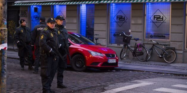 Armed police stand guard outside an internet cafe that was raided in connection with the twin attack...