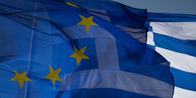 ATHENS, GREECE - JANUARY 23: The national flag of Greece and the flag of the European Union fly above...