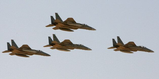 FILE - In this Sunday, Jan. 25, 2009 file photo, F-15 warplanes of the Saudi Air Force fly over the Saudi...