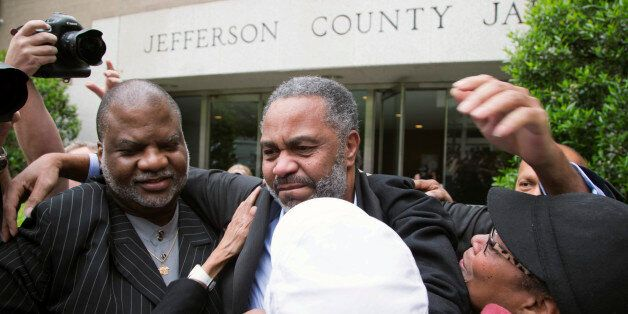 Friend Lester Bailey, left, and others greet Anthony Ray Hinton, center, as Hinton leaves the Jefferson...