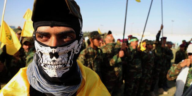 An Iraqi Shiite militiaman protests against the Saudi-led military campaign in Yemen, during a rally...