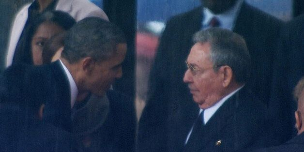 In this image from TV, US President Barack Obama shakes hands with Cuban President Raul Castro at the...