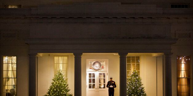 US Marine stands outside the West Wing of the White House in Washington, Friday, Dec. 12, 2014. Congress...