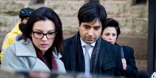 TORONTO, ON - FEBRUARY 11: Jian Ghomeshi (middle) leaves with co counsel Danielle Robitaille (left) and lawyer Marie Henein.Jian Ghomeshi exits the courthouse after his trial arguments ended. The verdict is to come March 24. (Carlos Osorio/Toronto Star via Getty Images)