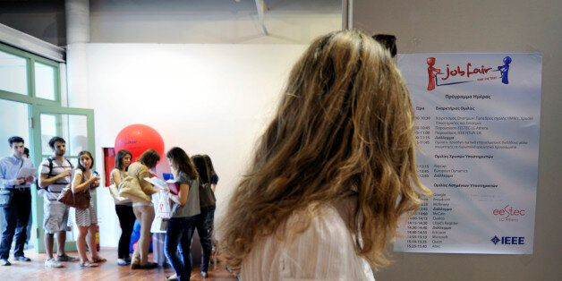 TO GO WITH AFP STORY BY ANNE-SOPHIE LABADIEStudents and young graduates visit on May 30, 2012 a job fair...