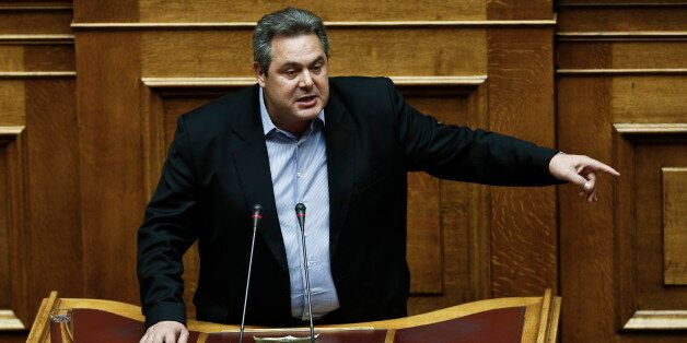Greek Defense Minister Panos Kammenos speaks during a parliament session before a vote of confidence...