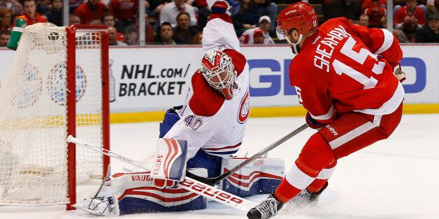 Detroit Red Wings center Riley Sheahan (15) scores on Montreal Canadiens goalie Ben Scrivens (40) in...